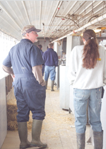 A group touring a barn.